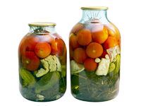canned tomatoes and cucumbers in a glass jar