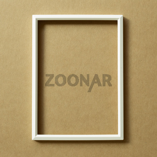 White photo frame on brown background. top view, copy space