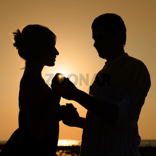 Sillhouette of loving couple at sunset