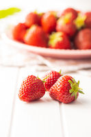 Whole ripe red strawberries.