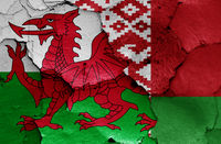 flags of Wales and Belarus painted on cracked wall
