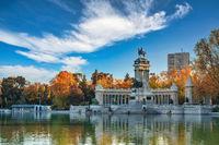 Madrid Spain, sunrise city skyline at El Retiro Park with autumn foliage season