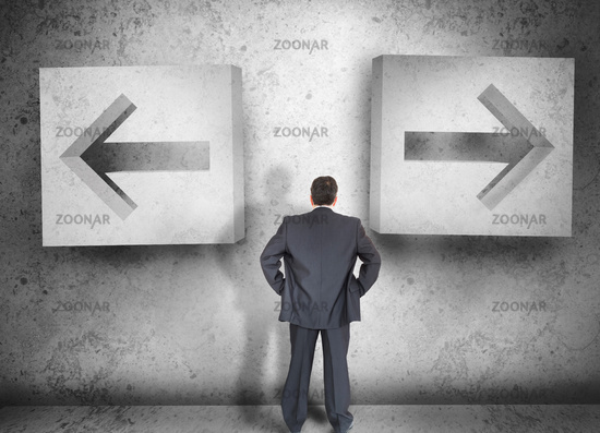 Businessman deciding which way to go