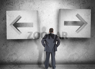 Businessman deciding which way to go