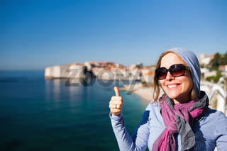 Tourist woman giving the thumbs up