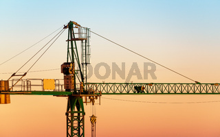 Tower crane at sunset