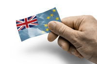 Hand holding a card with a national flag the Tuvalu
