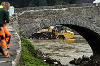 Flood disaster 2021, a dump rear tipper in the Ahr river behind the Nepomuk bridge, Rech, Germany