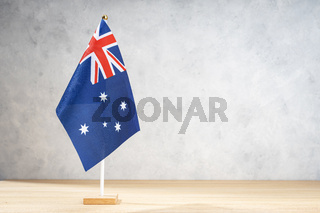Australian table flag on white textured wall. Copy space for text, designs or drawings