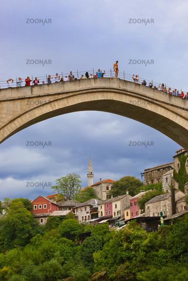 MOSTAR, BOSNIA AND HERZEGOVINA - SEPTEMBER 05: Jumping from the Old bridge on September 05, 2015 in Mostar, Bosnia and Herzegovina