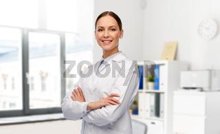 smiling female doctor in white coat at hospital