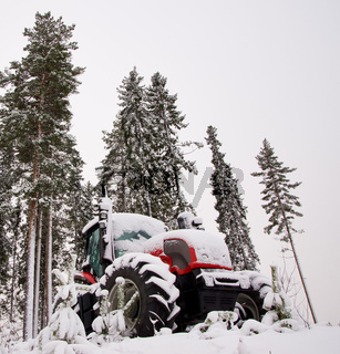 Tractor in winter forest