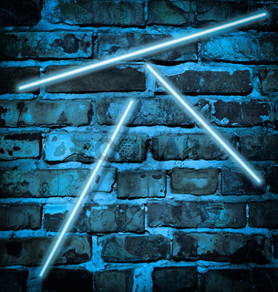 illuminated brick wall in blue neon color