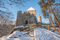 Medieval castle Kokorin in winter during sunrise. National park Kokorinsko nearby Prague in Czech Republic. Central Europe.