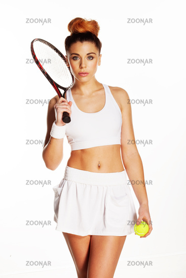 Pretty woman ready for a game of tennis