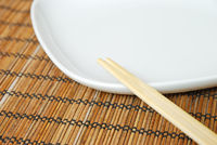Close-up of empty white plate and chopsticks