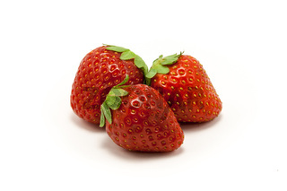 Three juicy strawberries on white background
