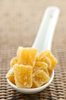 Candied ginger pieces in spoon