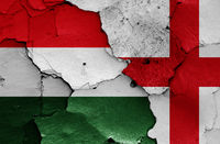 flags of Hungary and England painted on cracked wall