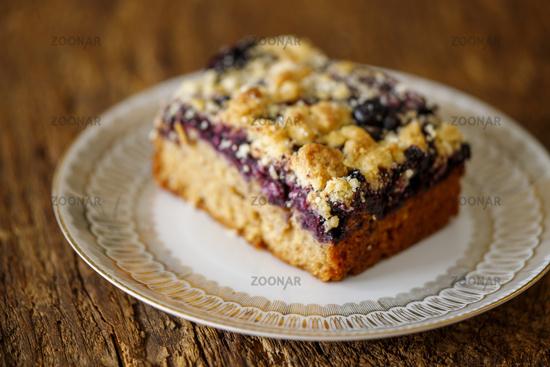 Blueberry pie on dark wood