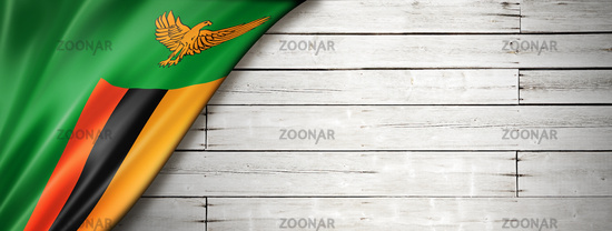 Zambian flag on old white wall banner