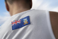 The national flag of Falkland Islands on the athlete's back