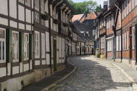 Goslar - Old town alley with numerous half-timbered houses, Germany
