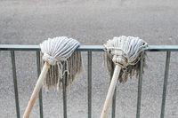 cleaning mop, two cleaning mops hanging to dry -