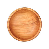 Round rustic empty wood bowl isolated on white