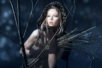 Beautiful woman in magic night forest