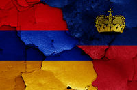 flags of Armenia and Liechtenstein painted on cracked wall