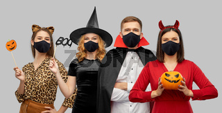 friends in halloween costumes and black masks