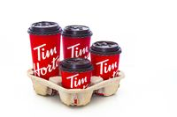 Calgary, Alberta, Canada. May 18, 2021. A trail with Tim Hortons coffee cups of four different sizes.