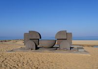 Sculpture on the beach in Piscinas