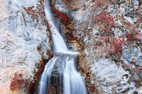 closeup of Dalbina waterfall in autumn season
