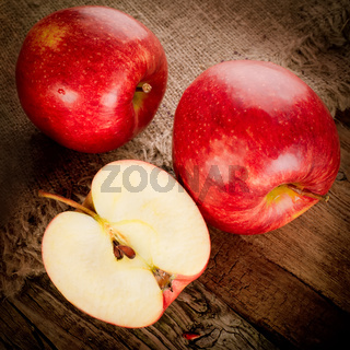 Fresh organic ripe apple fruits on wooden table