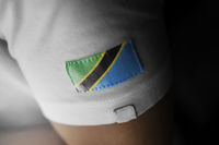 Patch of the national flag of the Tanzania on a white t-shirt