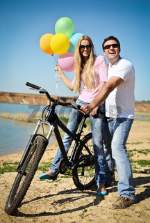 Happy smiling couple on bicycle