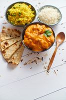 Fresh and tasty Butter Chicken served in ceramic bowl. Indian traditional dish