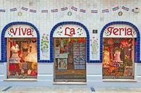 Decorated store windows of fashion store Viva la Feria in Malaga.