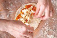 Fresh Italian raw pizza preparation