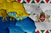 flags of District V. (Belvaros-Lipotvaros) and Budapest painted on cracked wall