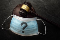 Court legal gavel and facemask with quetionmark -- Coronavirus mask mandate concept