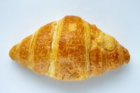 A Croissant on a white background.