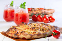 Italian flat bread (focaccia) with onions and herbs.