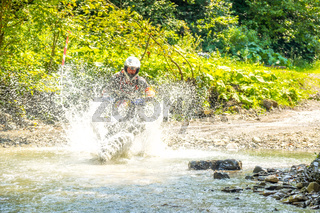Enduro and Lots of Water Spray on a Sunny Day