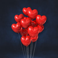 Red heart shape balloons bunch on a black wall background