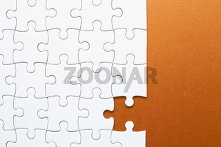 Set of white puzzle pieces and last one piece