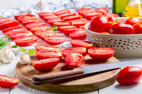 Preparation of dried tomatoes.