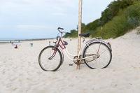 Bicycle on the beach of the Polish Baltic Sea near Kolobrzeg
